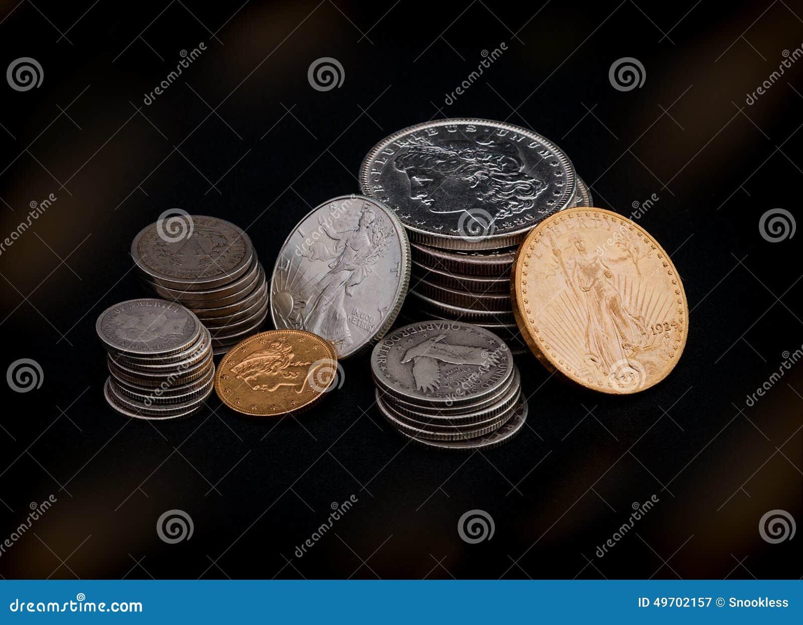 Oro y monedas de plata