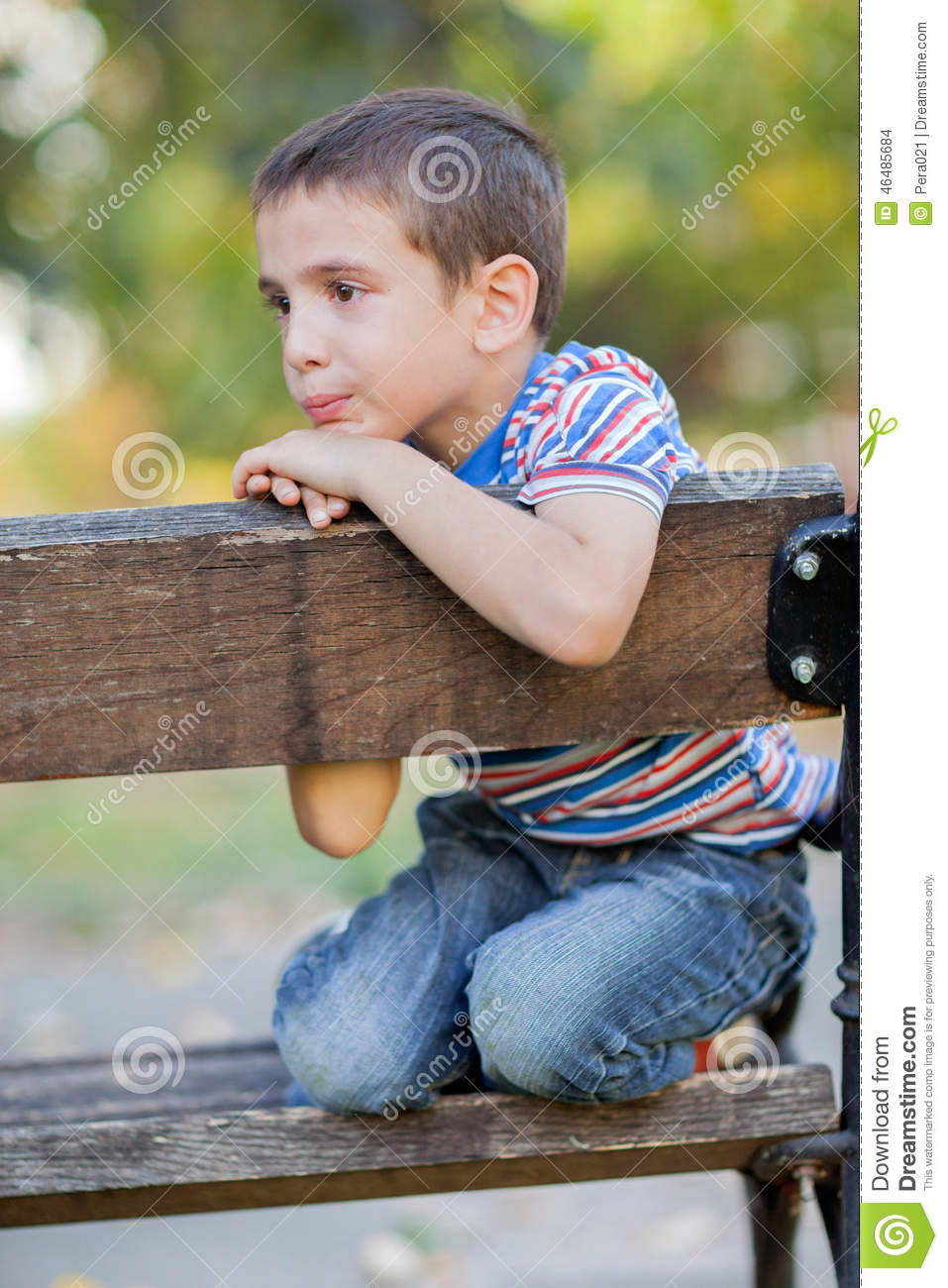 Orphan, Unhappy Boy Sitting On A Park Bench And Crying Stock Photo - Image: 46485684