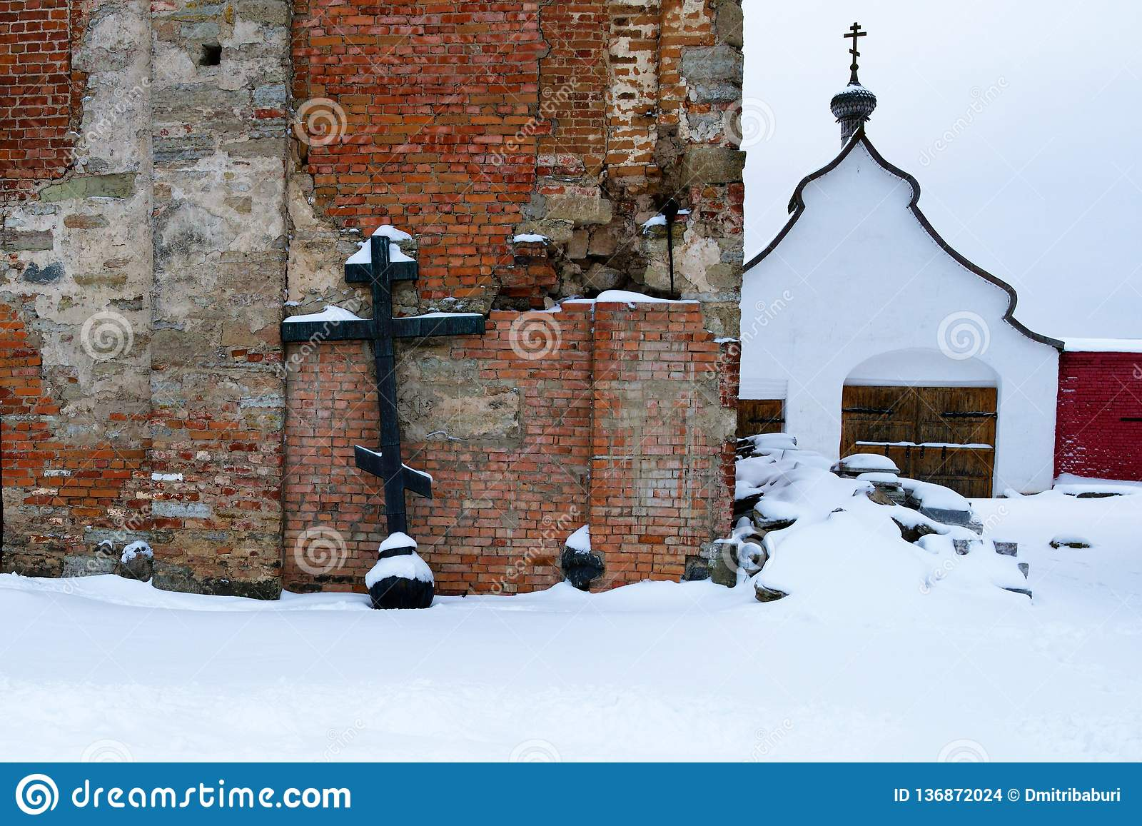 Orthodox cross, shot from the dome of the dilapidated chapel in the men`s monastery, Russia, winter.