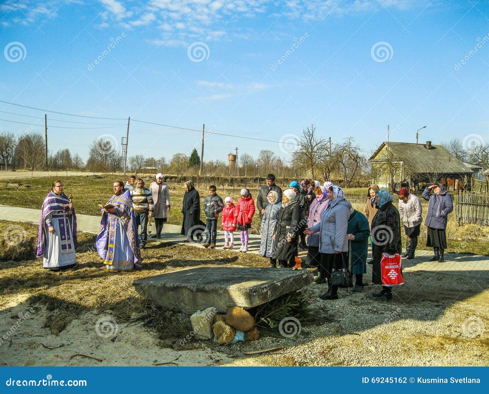 Orthodox divine service near the temple in the Kaluga region in Russia (2014).