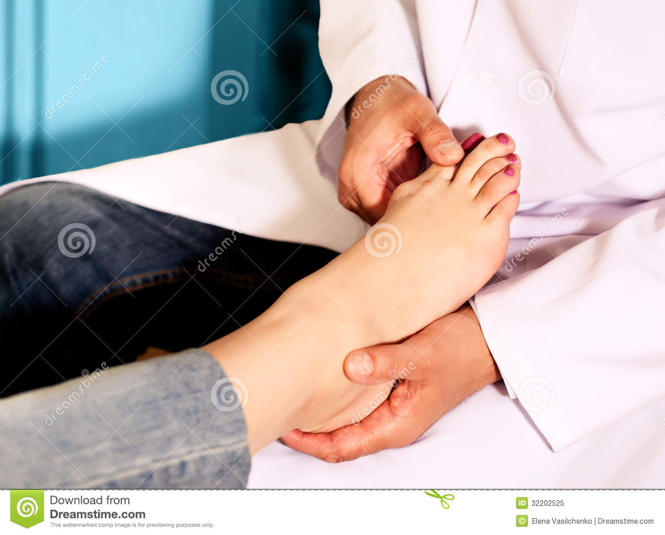 Orthopedic Doctor In His Office With The Model Of The Feet