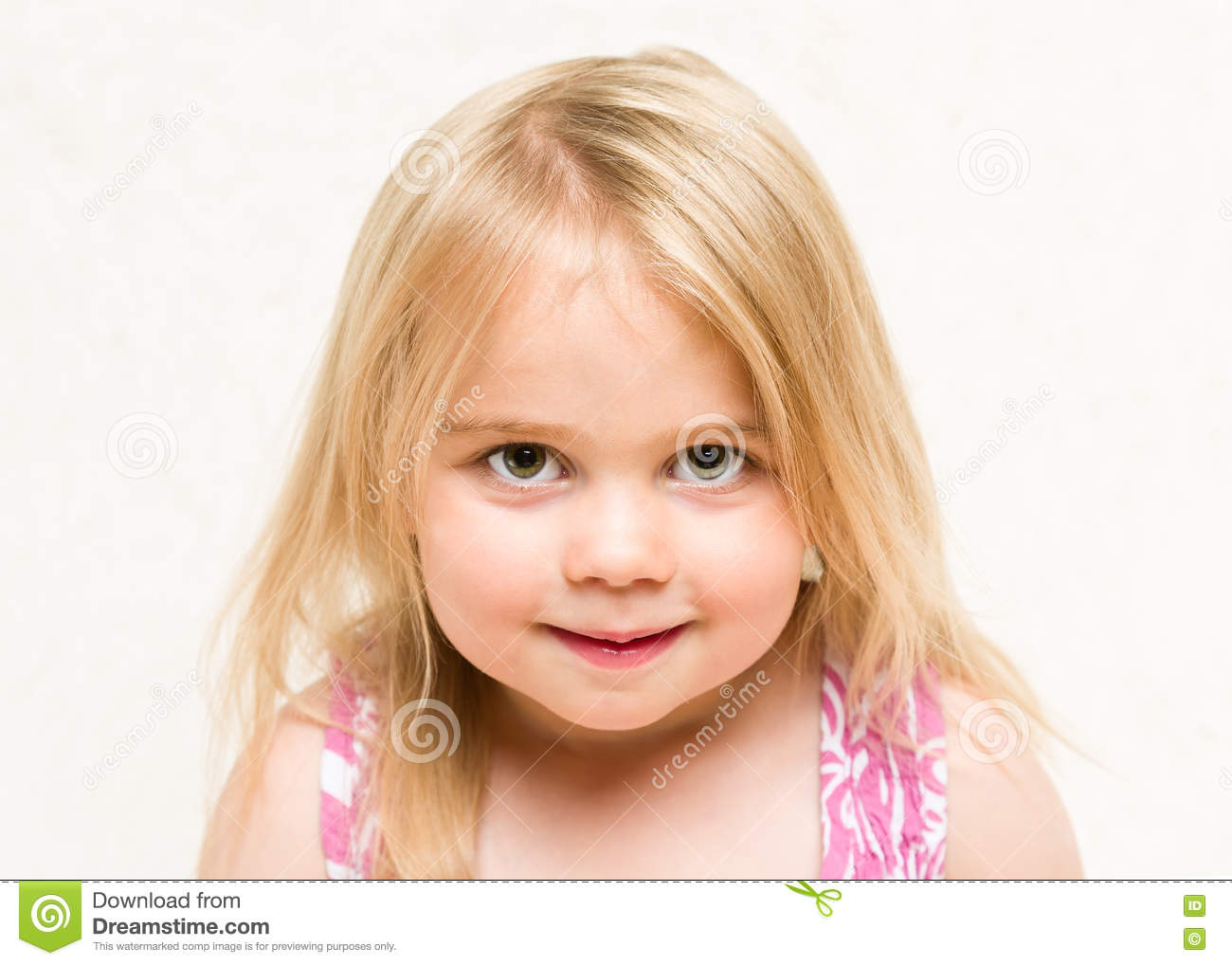 Ortrait of beautiful blonde toddler baby girl with cheeky grin