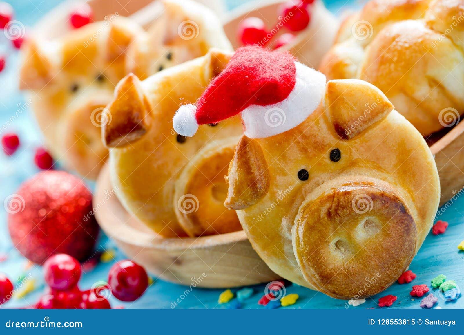 Os bolos do pão do porco, ideia engraçada do cozimento deram forma às caras leitães bonitos