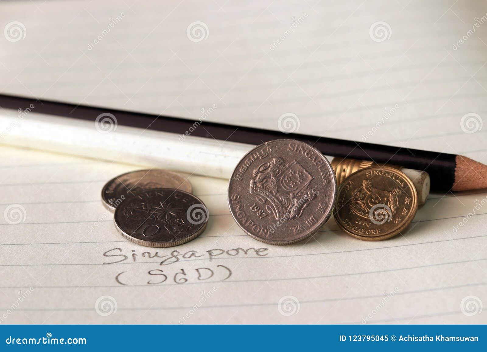 Os centavos de Singapura inventam no SGD do anverso com lápis preto e branco