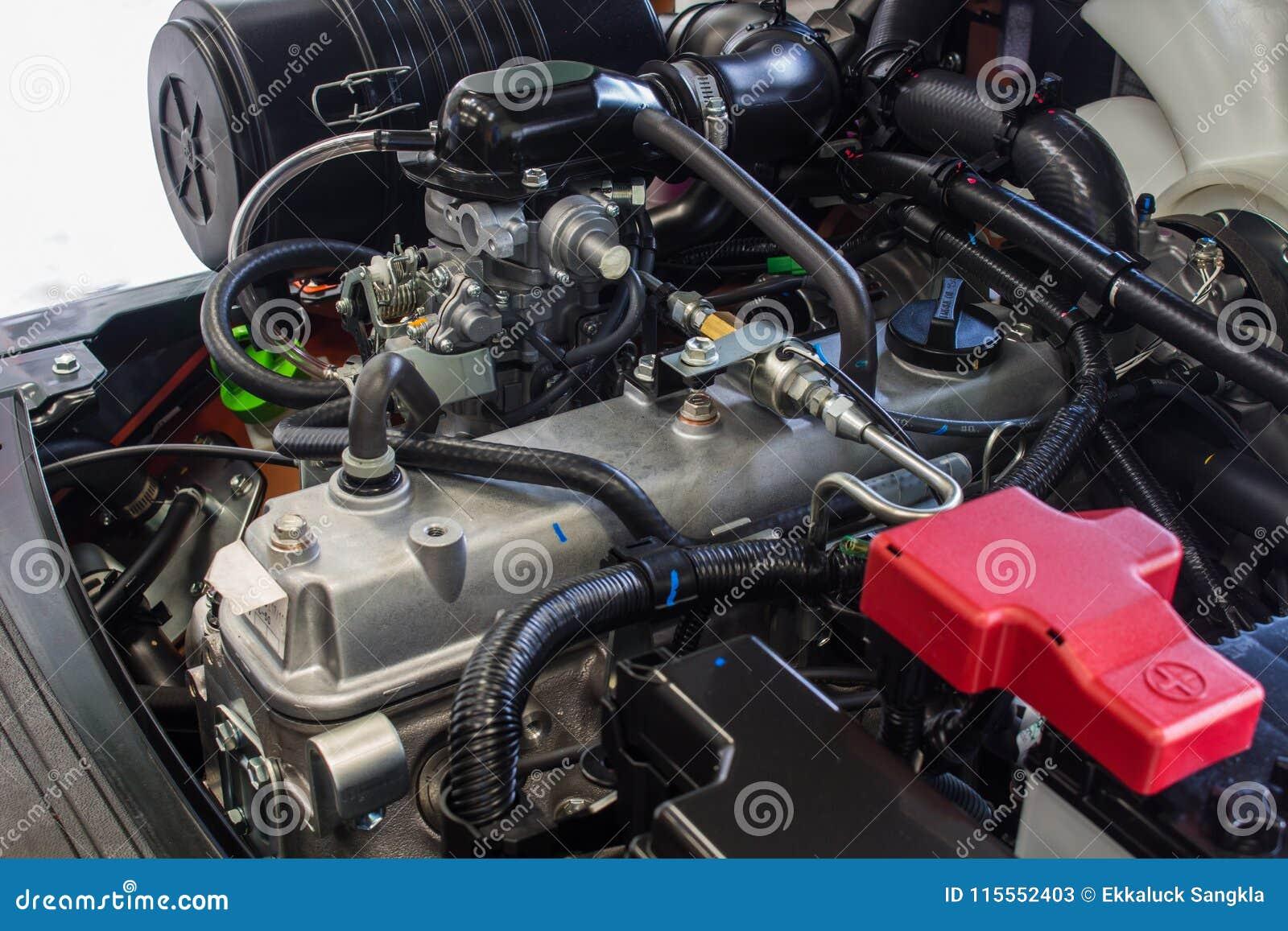 Os componentes - motor da empilhadeira do equipamento