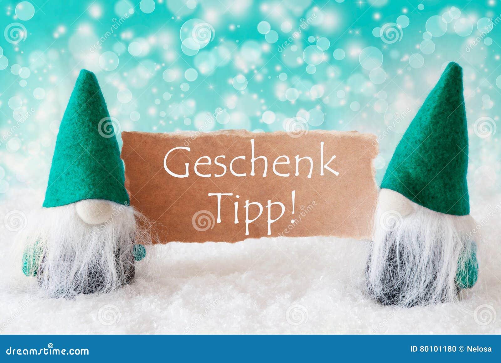 Os gnomos de turquesa com cartão, Geschenk Tipp significam a ponta do presente