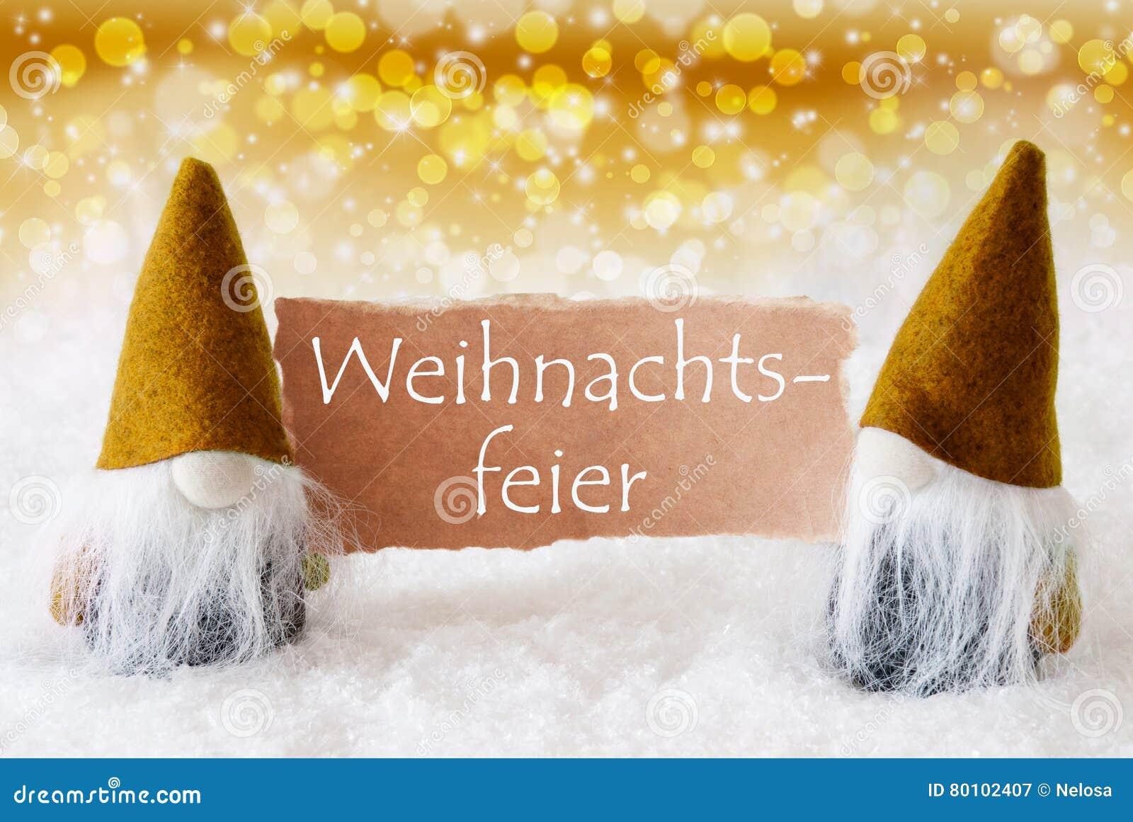 Os gnomos dourados com cartão, Weihnachtsfeier significam a festa de Natal