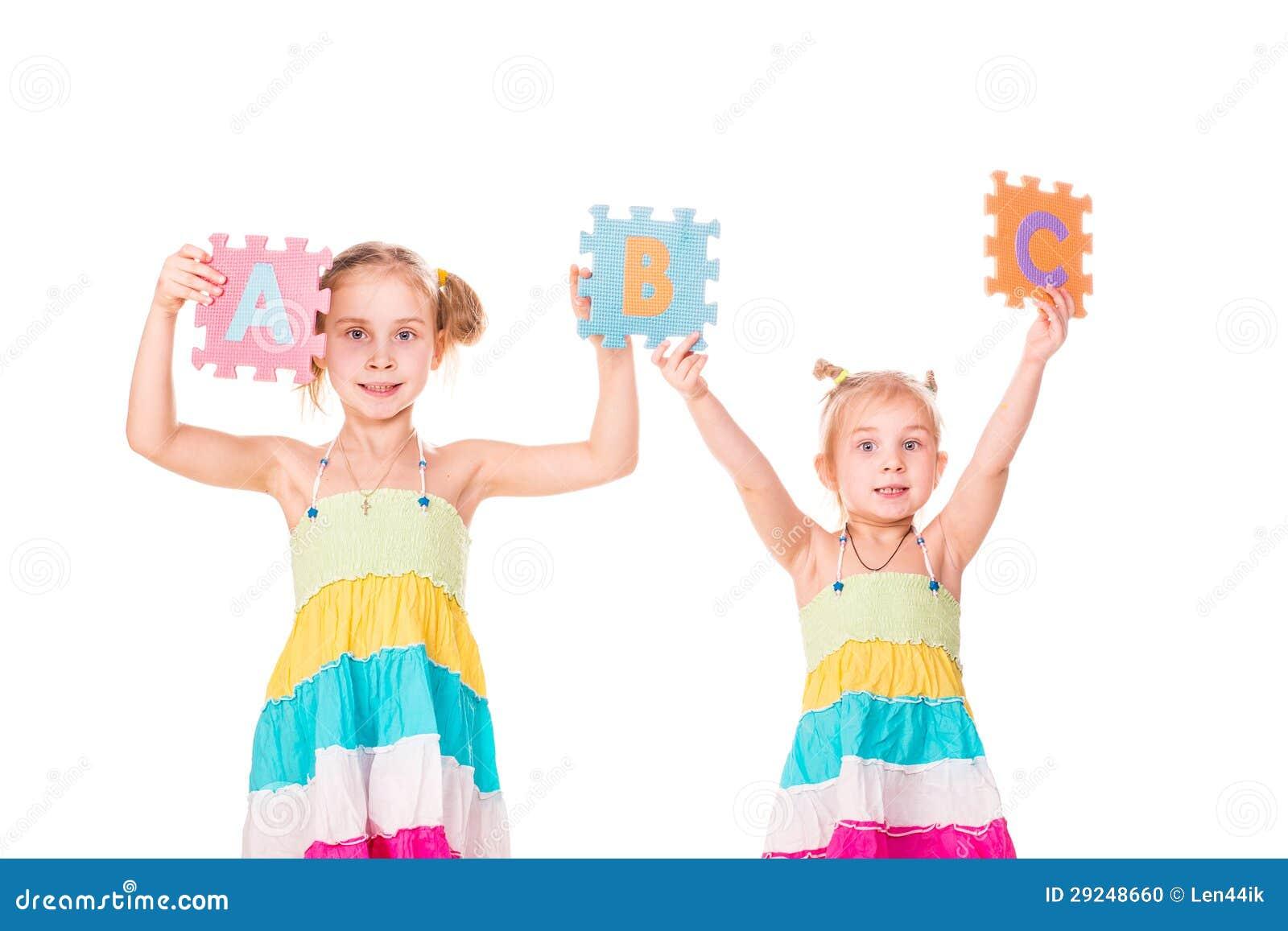 Download Os Miúdos Felizes Que Guardaram O Alfabeto Rotulam ABC Foto de Stock - Imagem de communication, face: 29248660