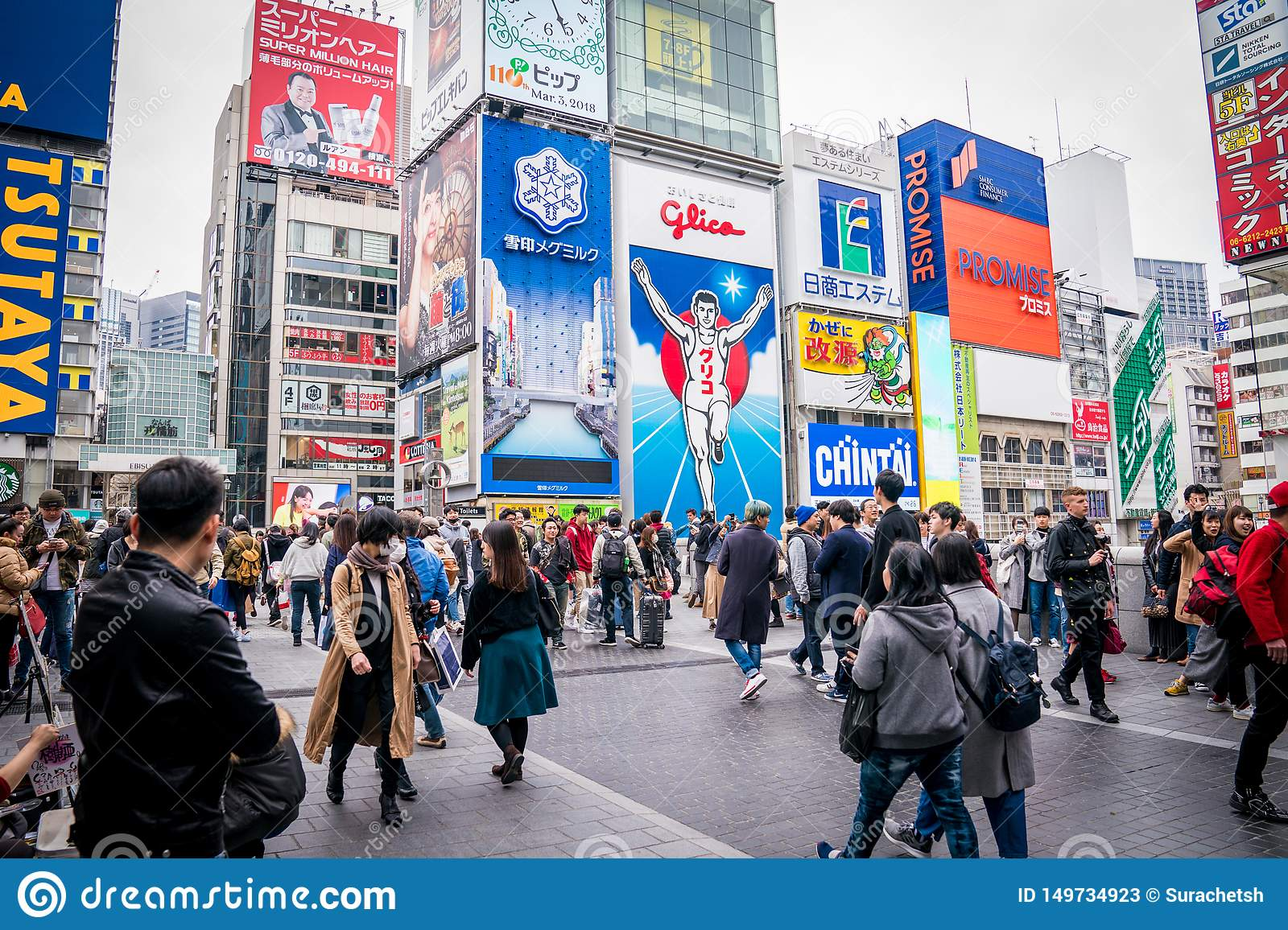 Osaka, Japan - 3 Mar 2018: The Gulico man digital signage billboard is the popular landmark / tourist attraction in the noon at