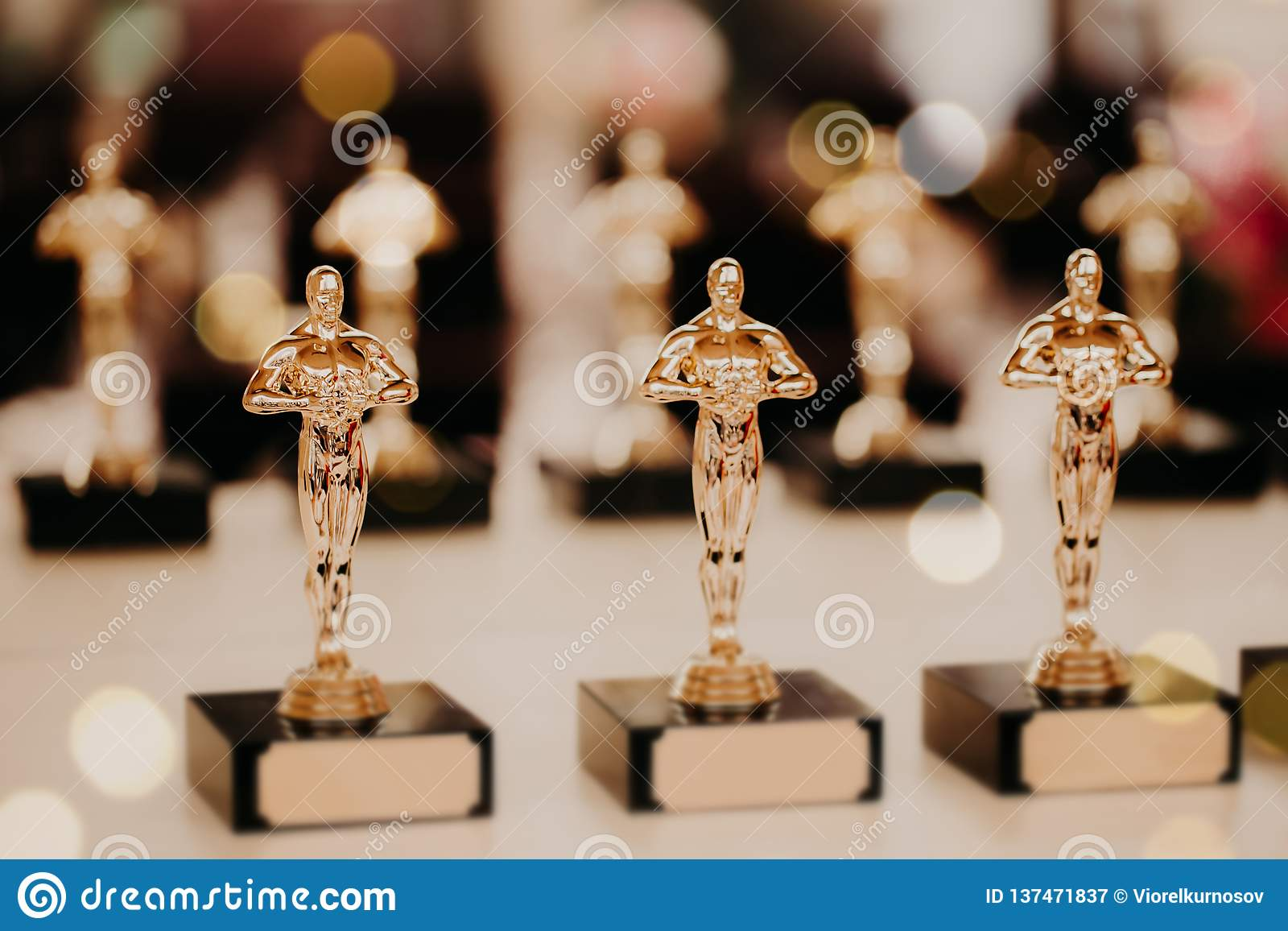 Oscar award. Prize for victory. Golden trophy,. Success concept. Horizontal shot. Prize in film production