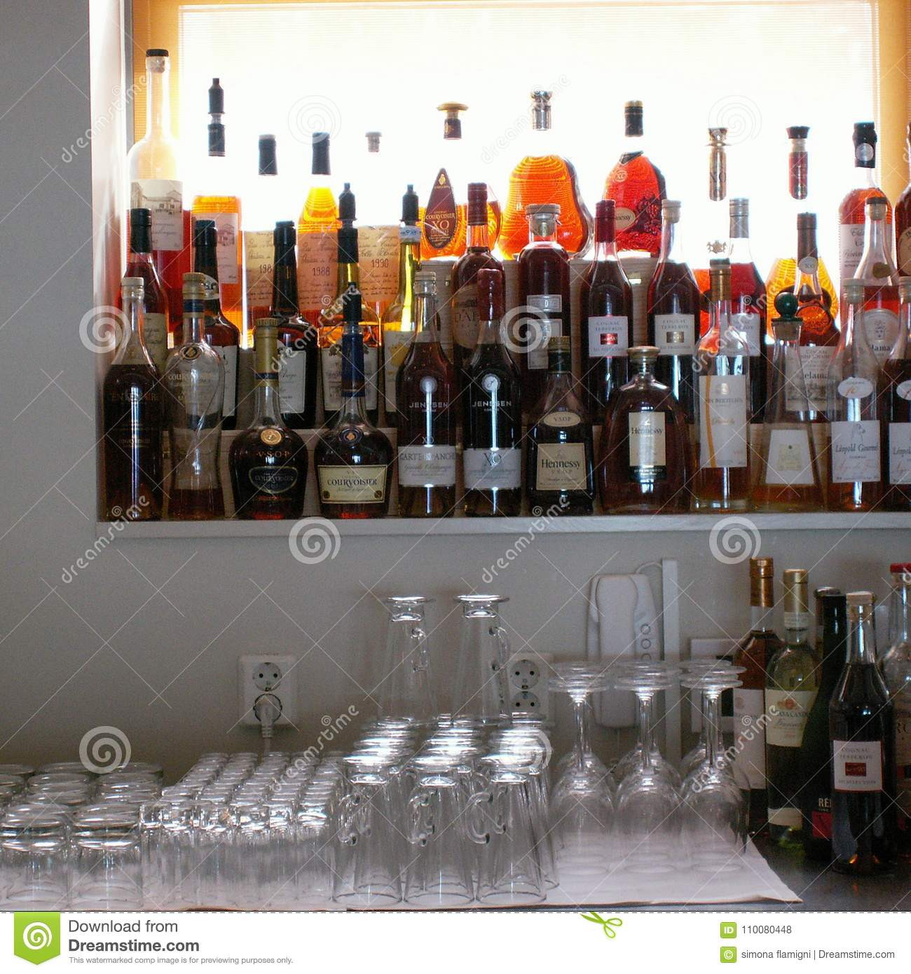 Liquors bottles in a bar editorial stock photo  Image of
