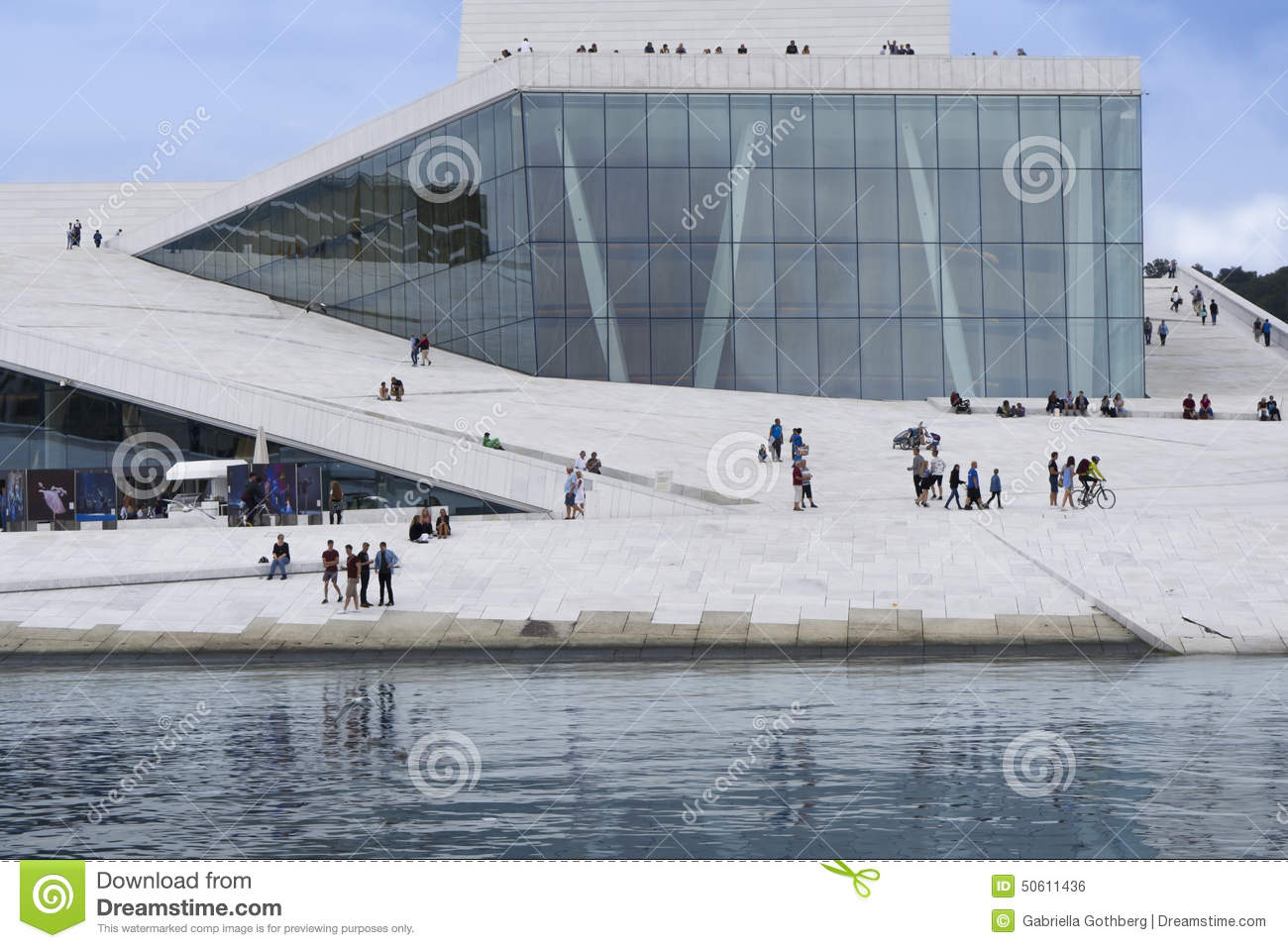 Oslo opera house with people and reflection