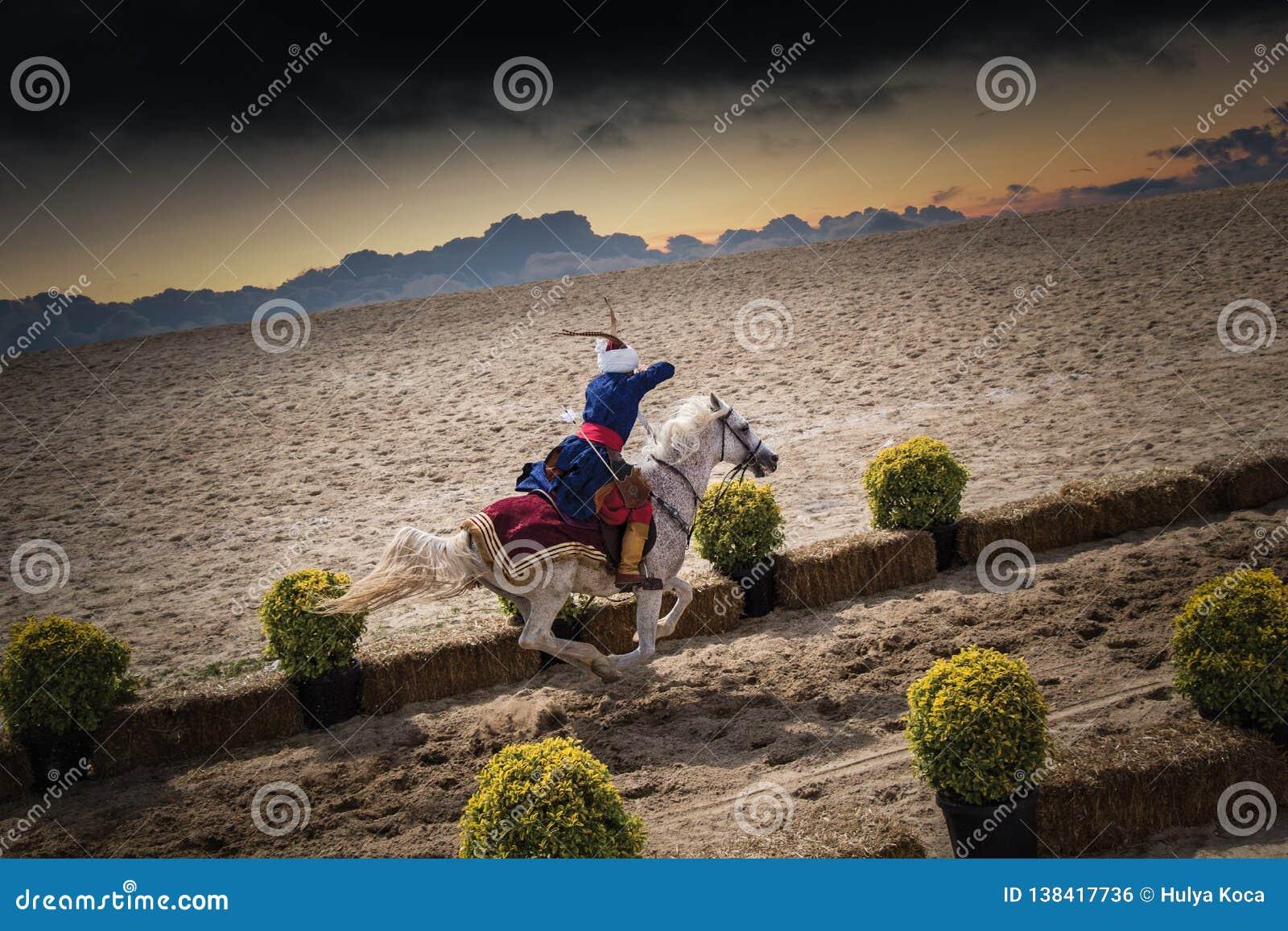 Osmańska jeździec łuczniczki jazda i strzelanina