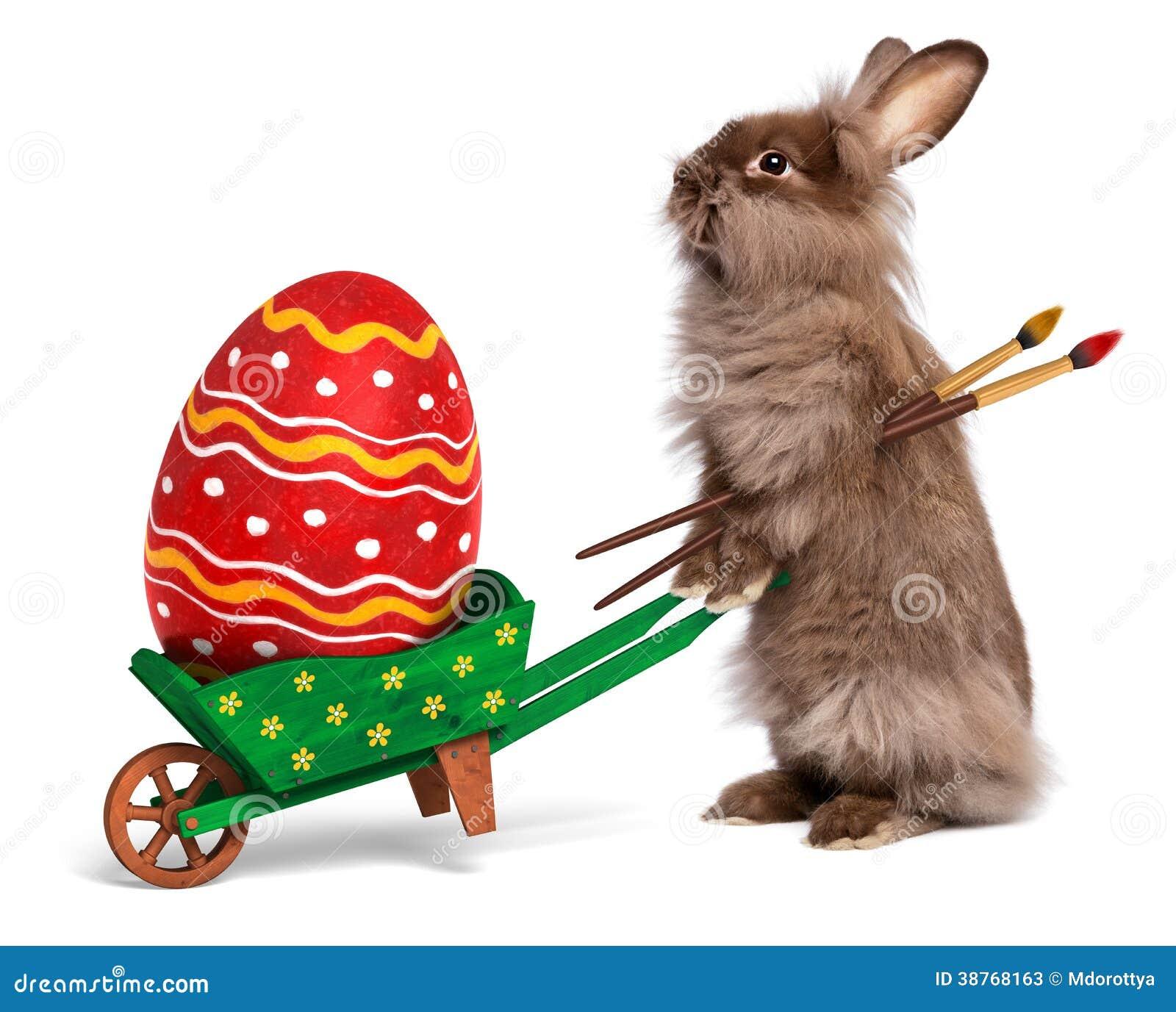 Ostern-Kaninchen mit einer Schubkarre und einem Osterei