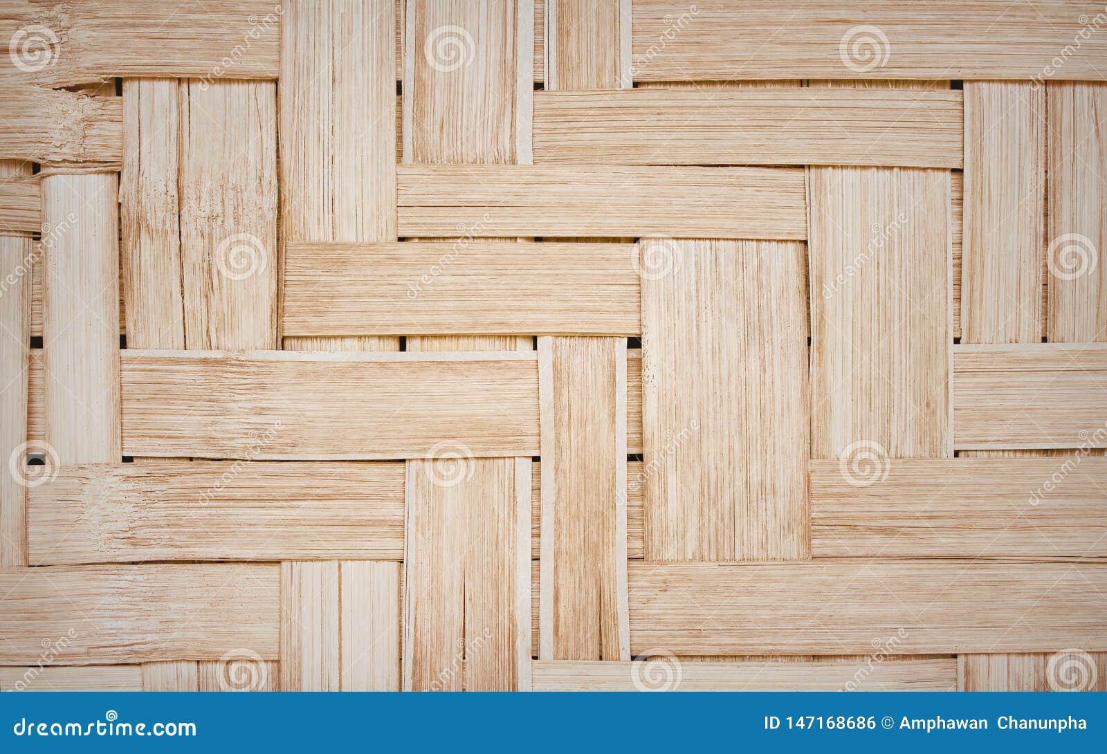 Oud aardbamboe dat met de gevoelige textuur van lijnpatronen voor achtergrond wordt geweven