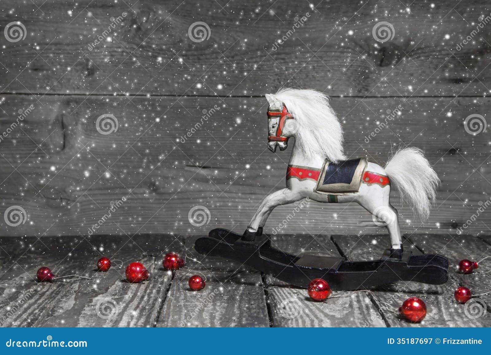 Oud houten paard - sjofele elegante Kerstmisdecoratie - achtergrond