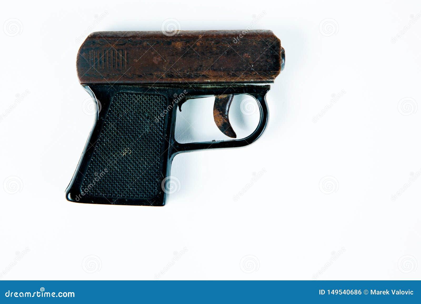 Oud roestig beginnend pistool met zwarte plastic greep