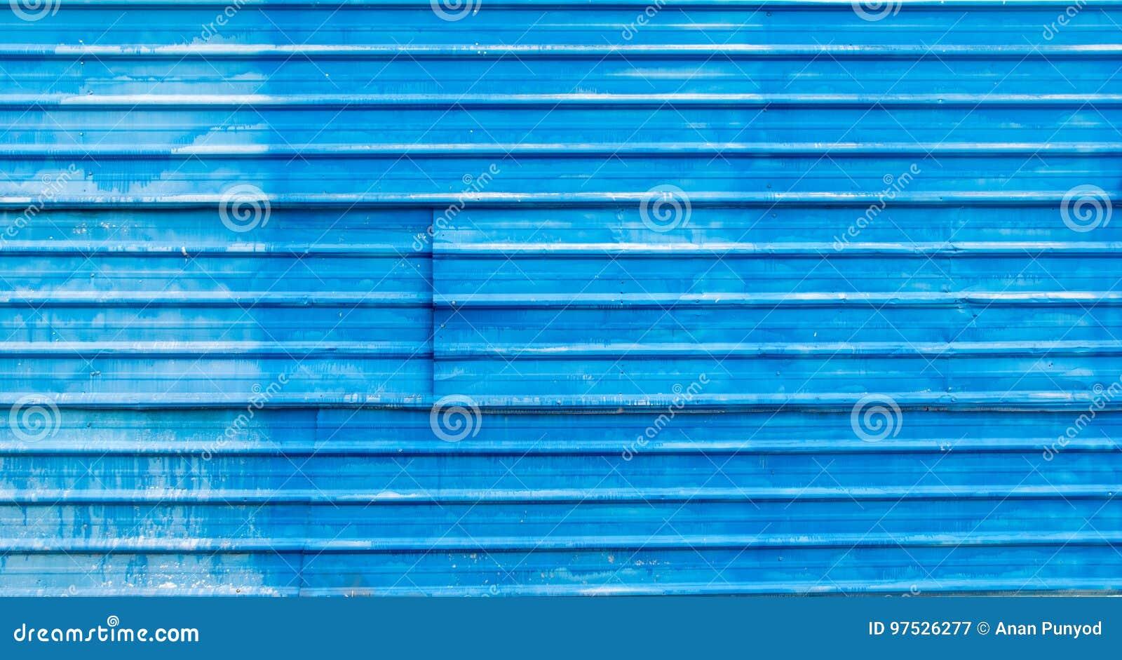Oude Blauwe die Muur van de textuurachtergrond van het staalplaatdak wordt gemaakt
