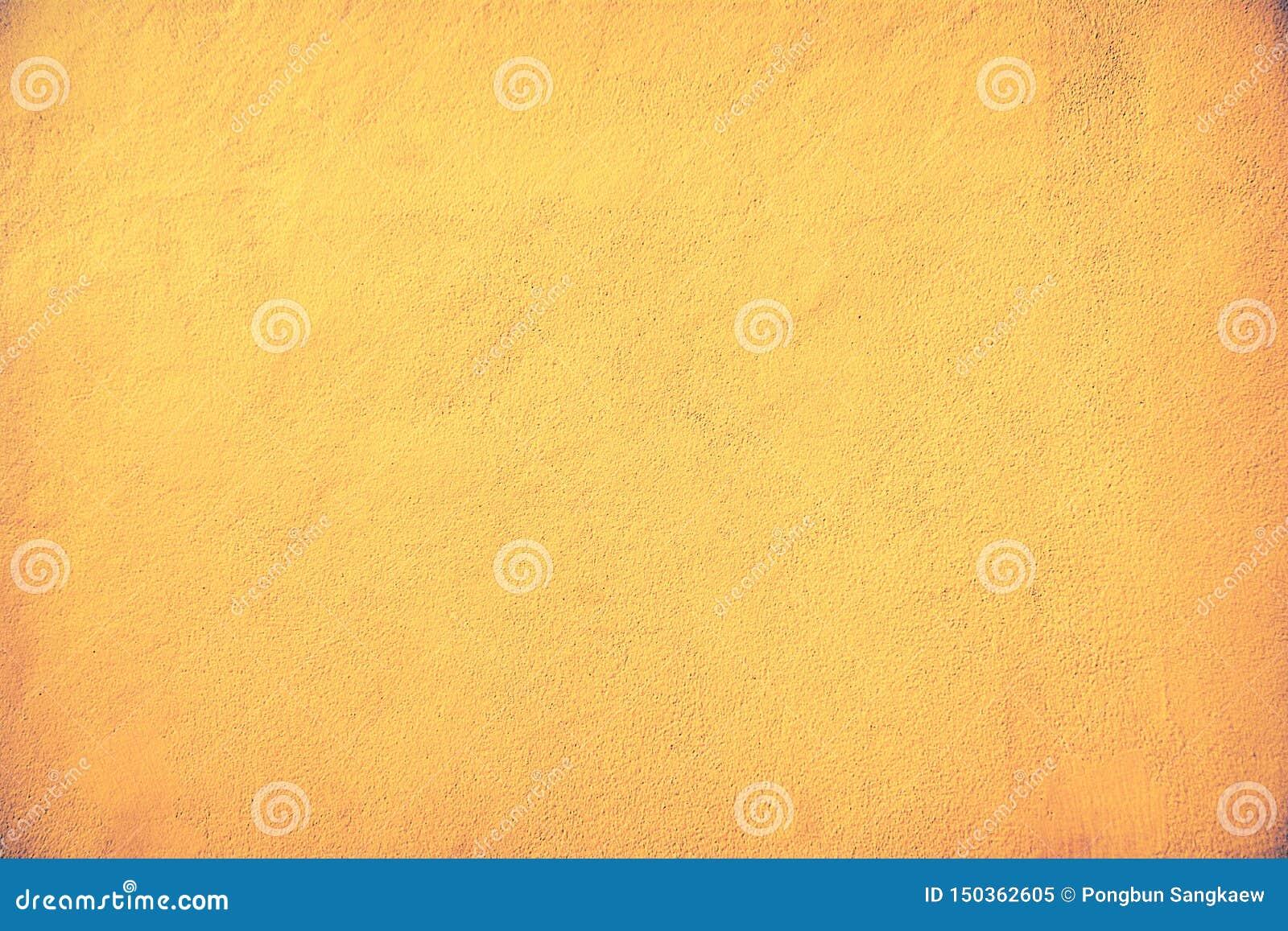 Oude bruine en gouden kleur van de concrete achtergrond van de muurtextuur