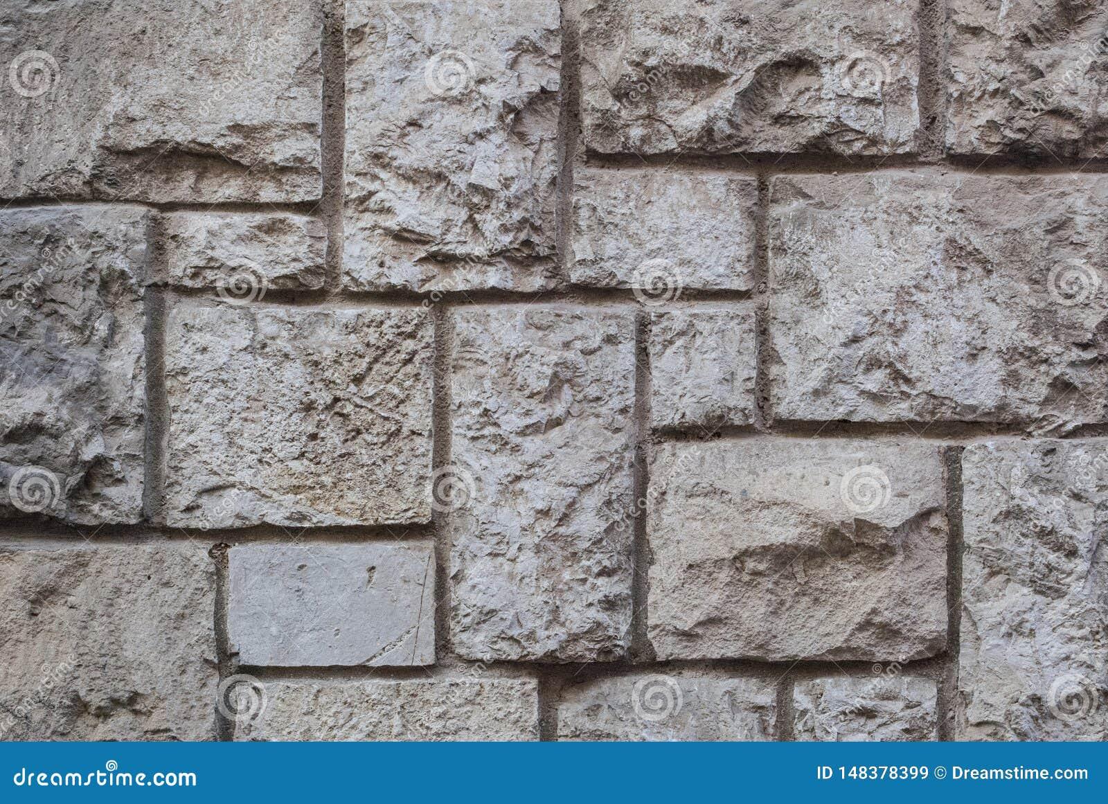 Oude gehouwen steenmuur, mooie textuur als achtergrond