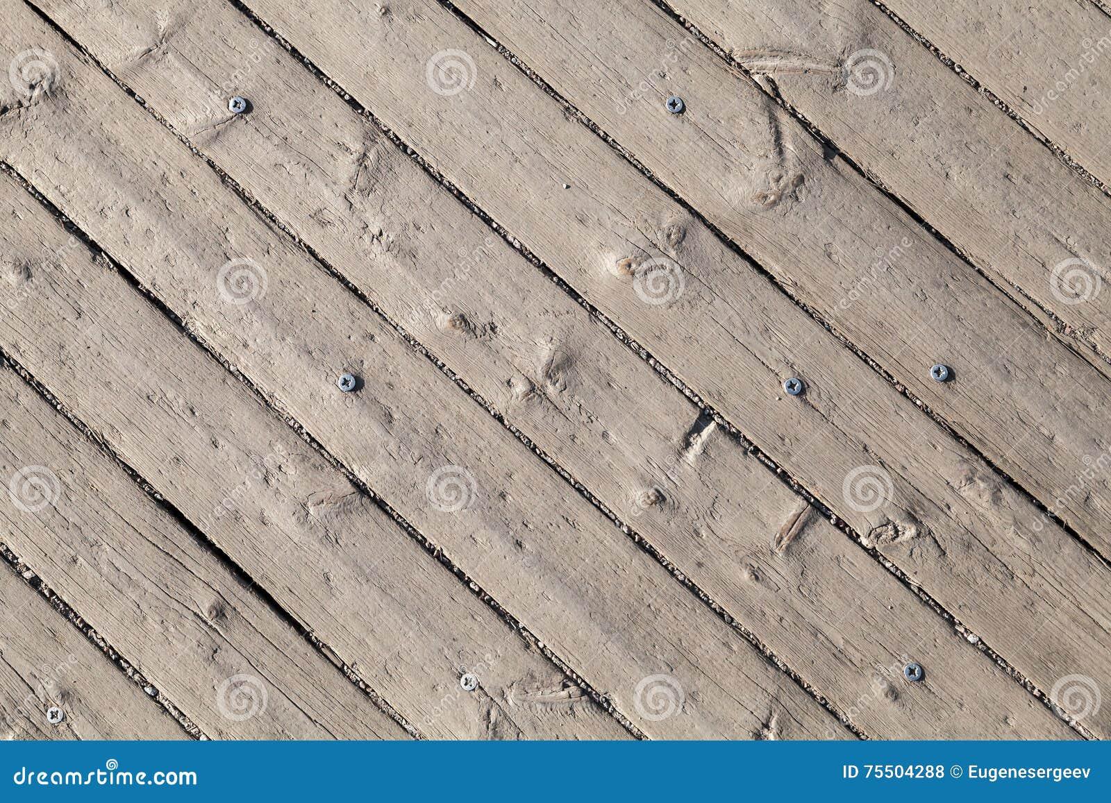 Oude grijze houten vloer met schroef achtergrond stock foto