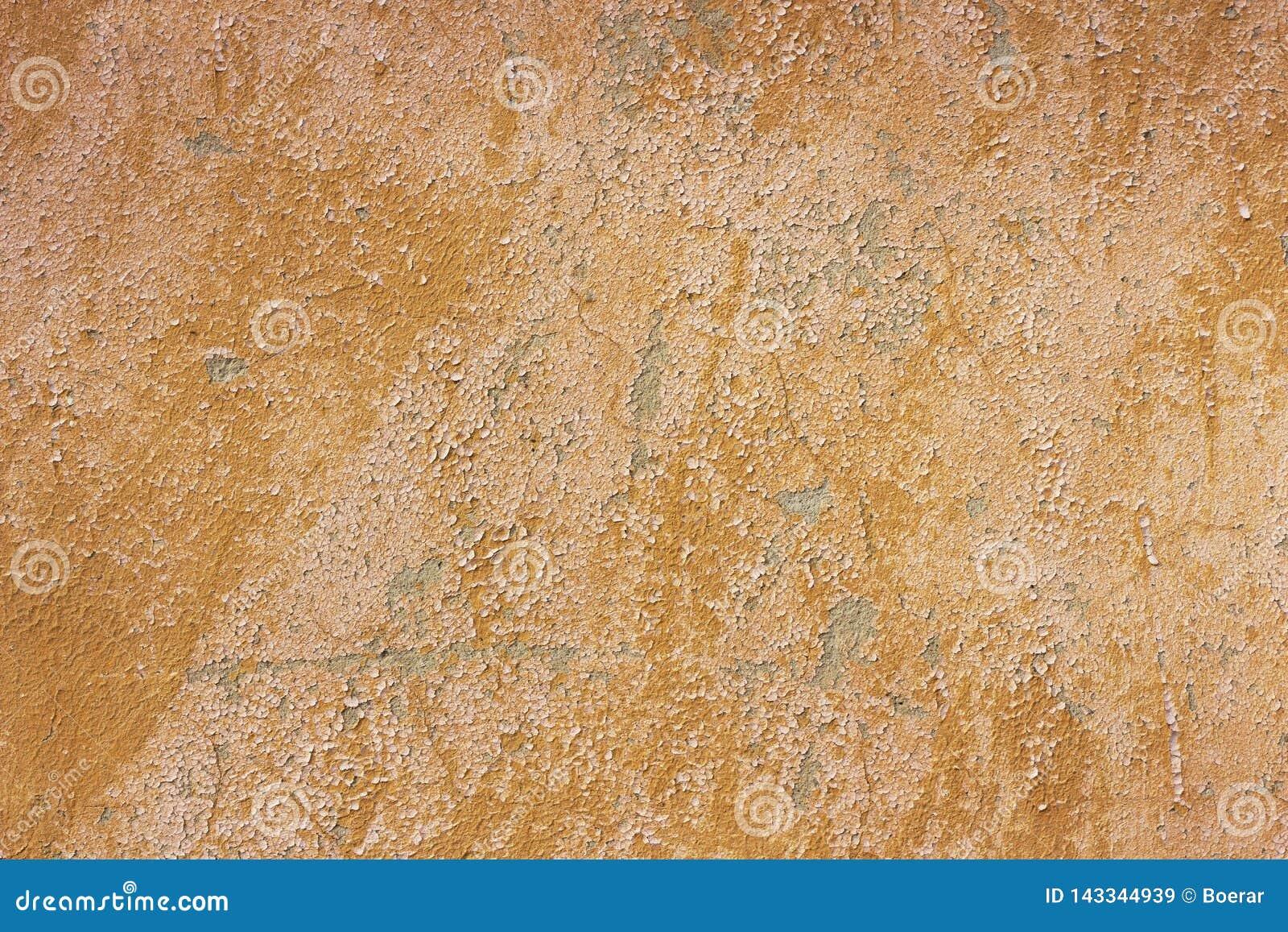 Oude grunge barstte uitstekend lichtbruin beton en cementeert de muur van de vormtextuur of vloerachtergrond met doorstane verf