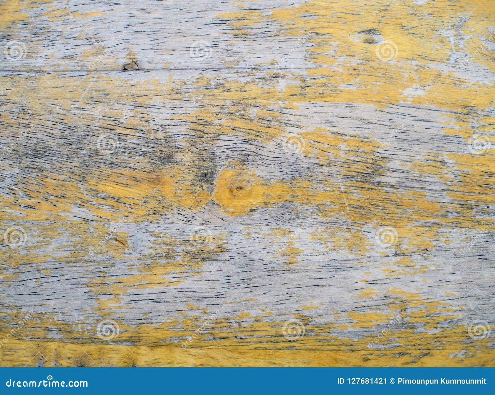 Oude houten achtergrond, Pellende verf, houten textuur Gele kleuren uitstekende stijl