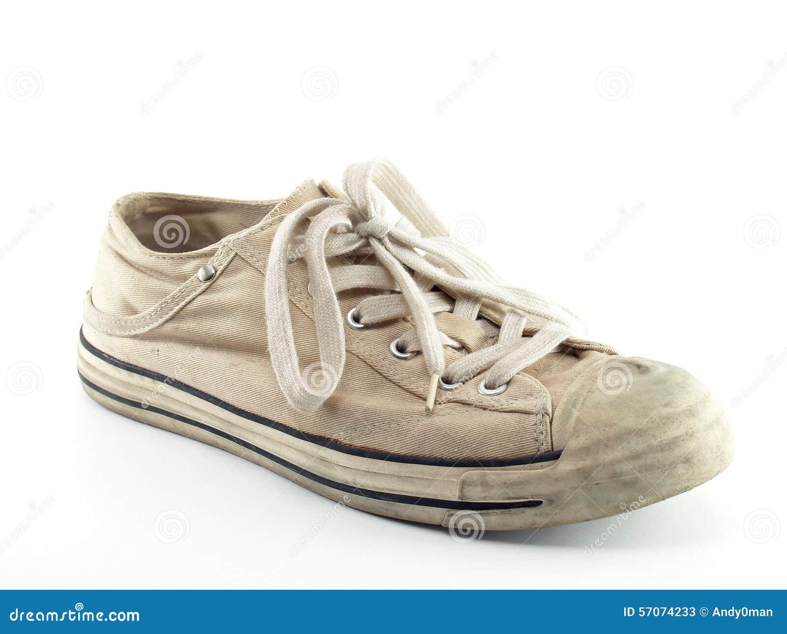 Oude witte tennisschoenen