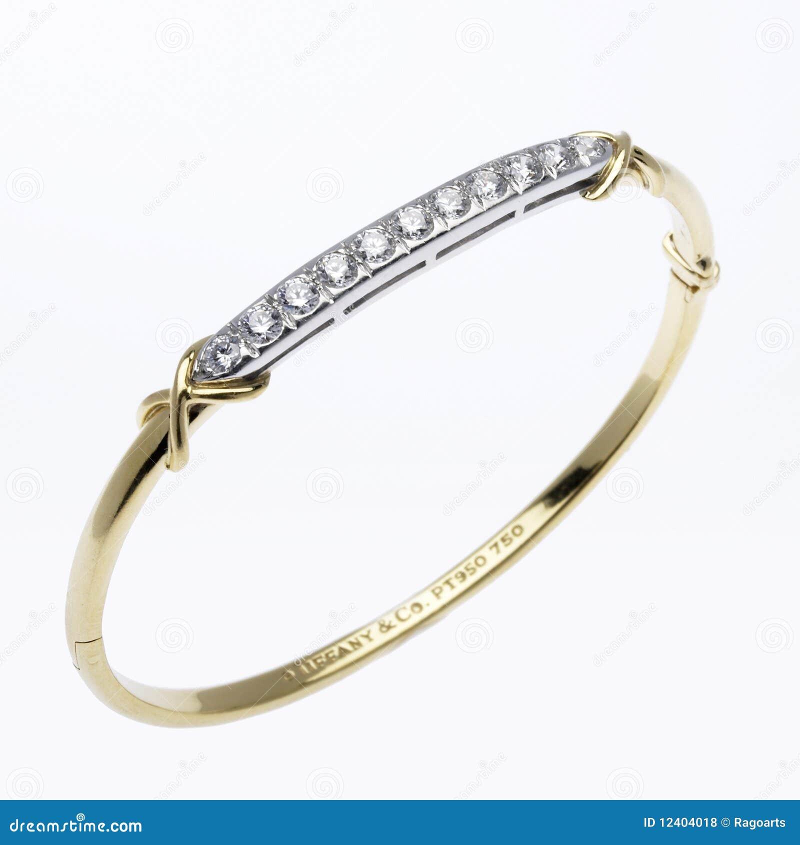 Ouro e bracelete do diamante