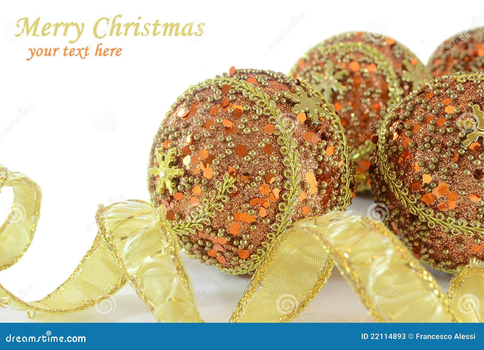 Ouro e decorações alaranjadas do Natal