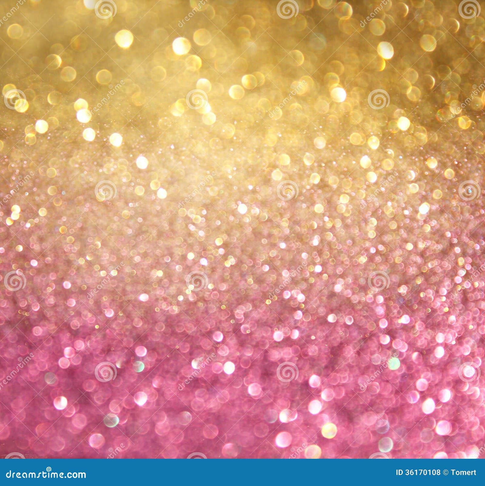 Ouro e luzes abstratas do bokeh do rosa. fundo defocused