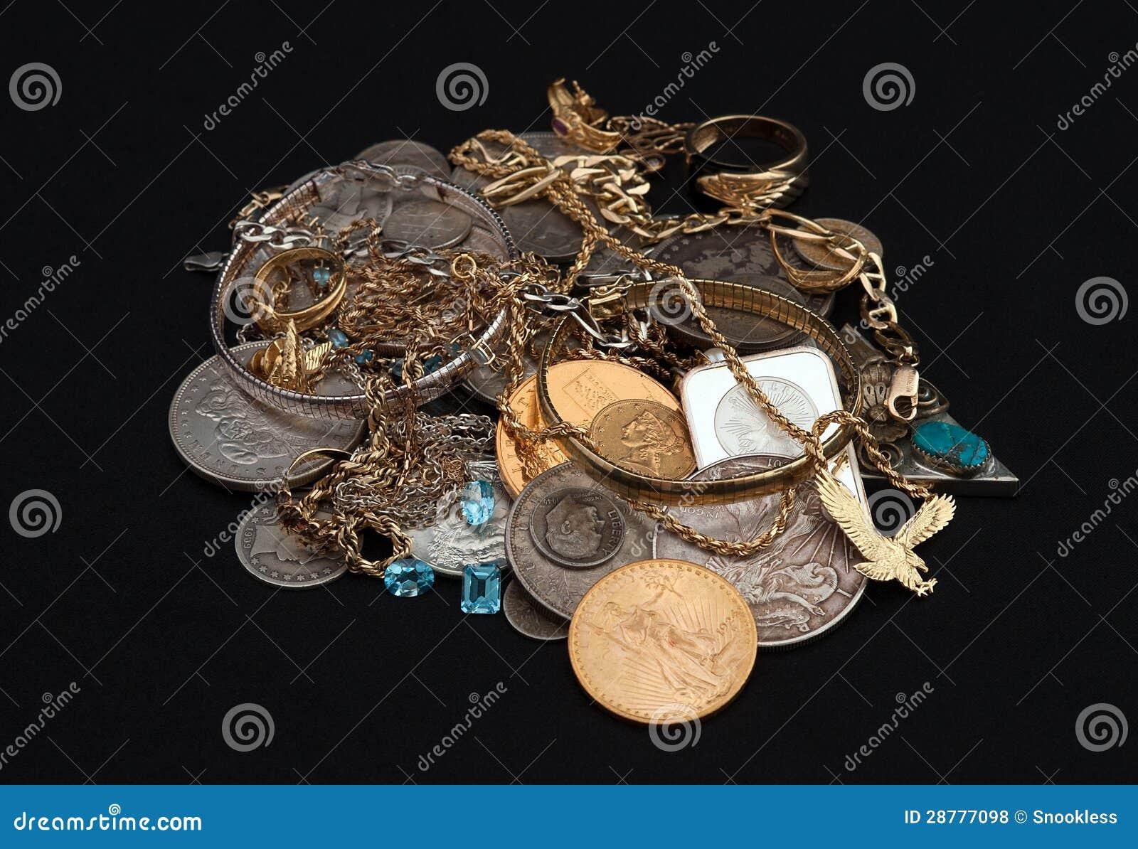 Ouro e prata da sucata com moedas