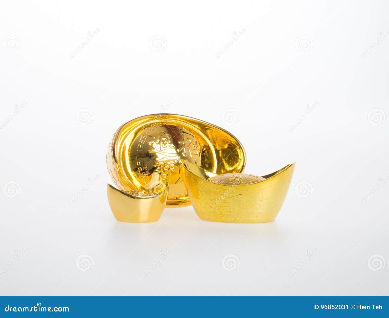 Ouro ou símbolos chineses do meio do lingote do ouro da riqueza e da prosperidade