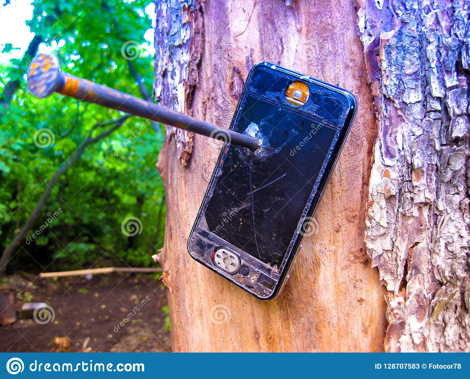 Out of coverage. Nailed to a tree broken phone.