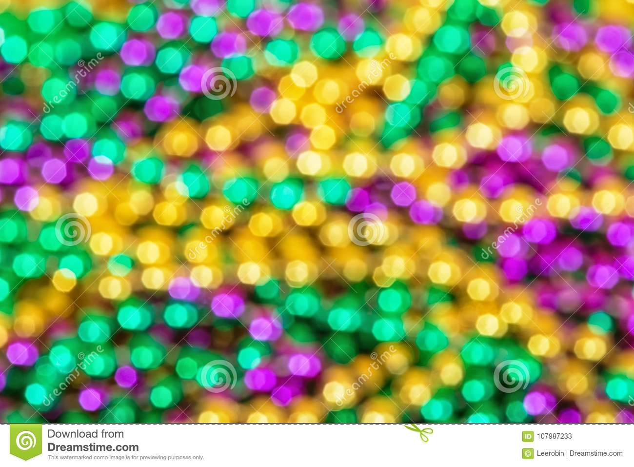 Out of focus background of colorful Mardi Gras beads