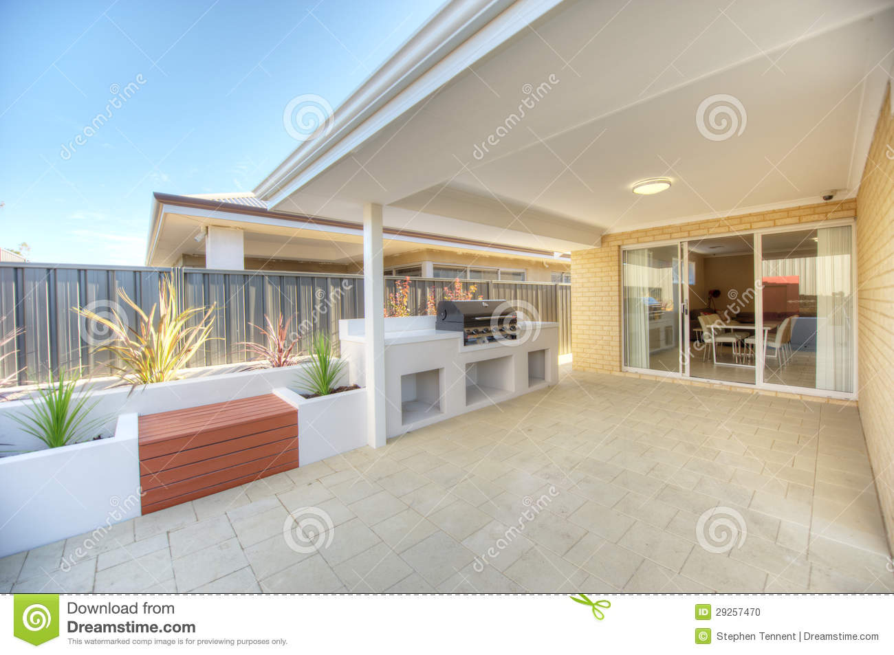Outdoor alfresco eating and entertaining area with oven and wooden ...