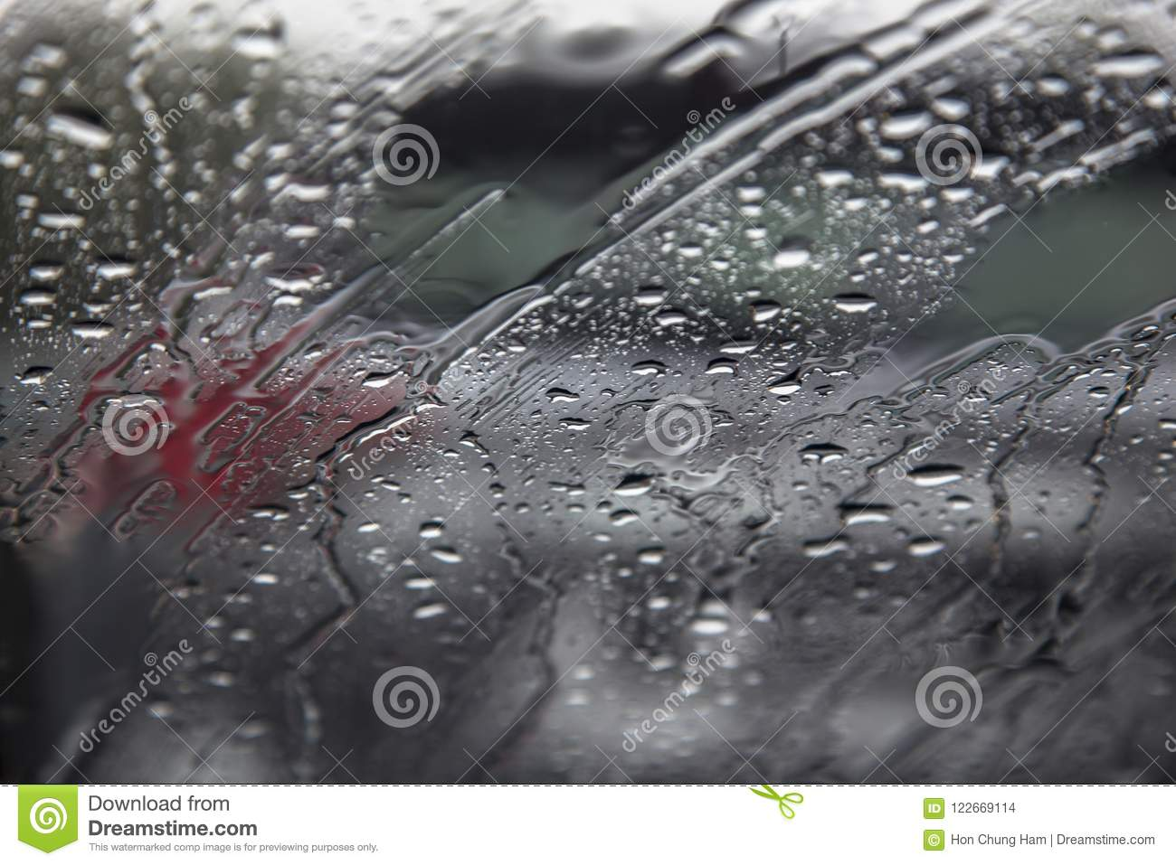 Outdoor bike stunt activity of a cyclist on a bicycleClose up texture abstract background of raindrop on car windscreen window