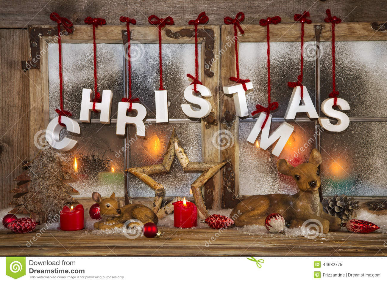 Outdoor christmas window decorations - Outdoor Christmas Window Decoration With Red Candles Deer And T Stock Photo