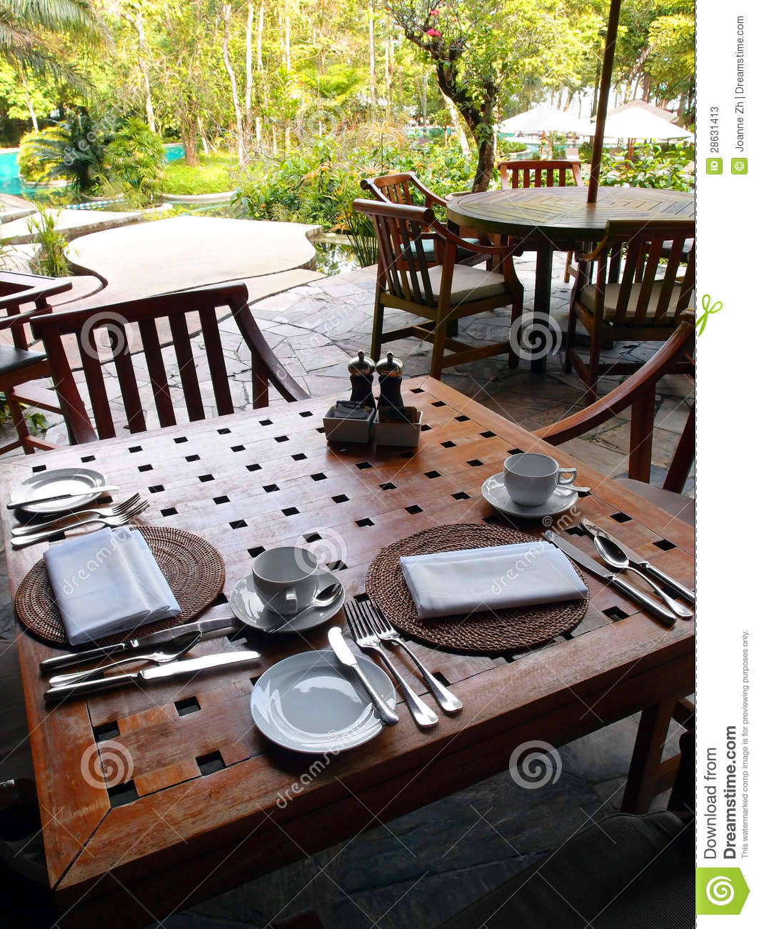 Outdoor dining restaurant table cutlery settings stock Outdoor dinner table setting