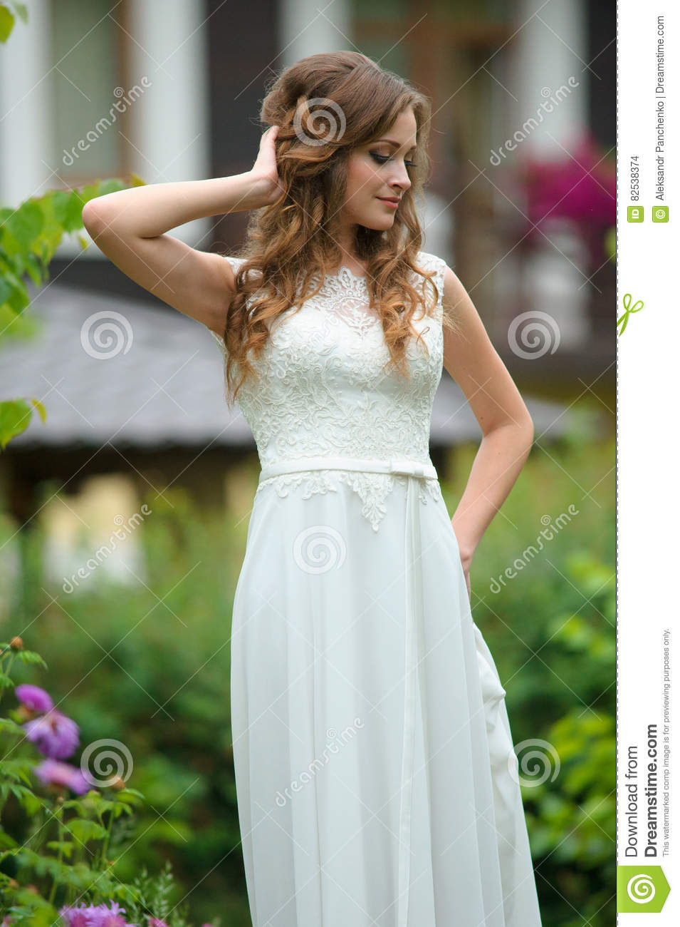 Outdoor fashion portrait of young pretty happy woman in summer o