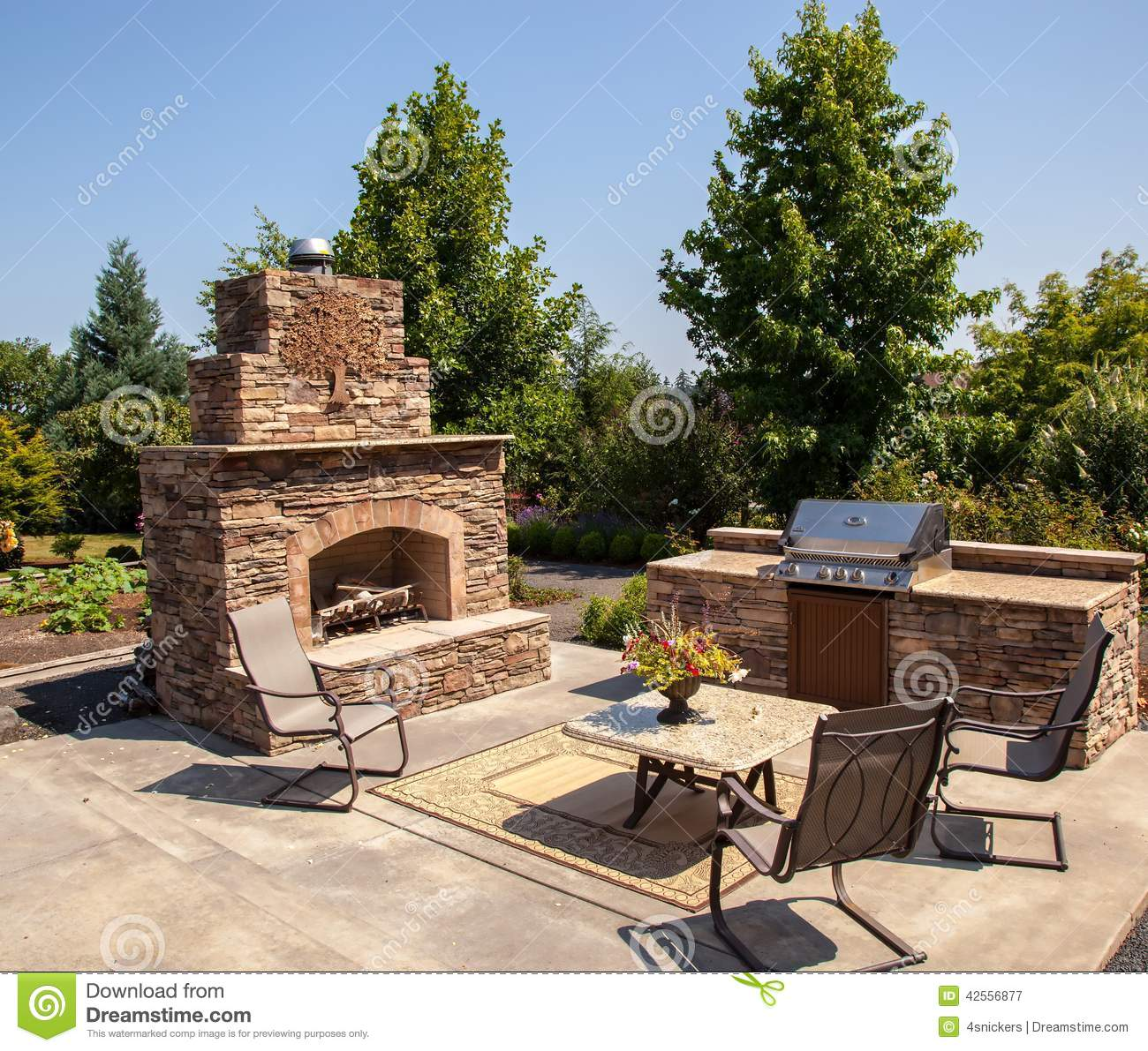 Outdoor fireplace and kitchen area summer stock photo for Outdoor cooking area and fireplace