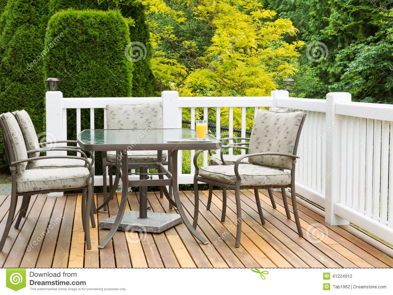 Closeup horizontal photo of outdoor furniture on open cedar patio with ...