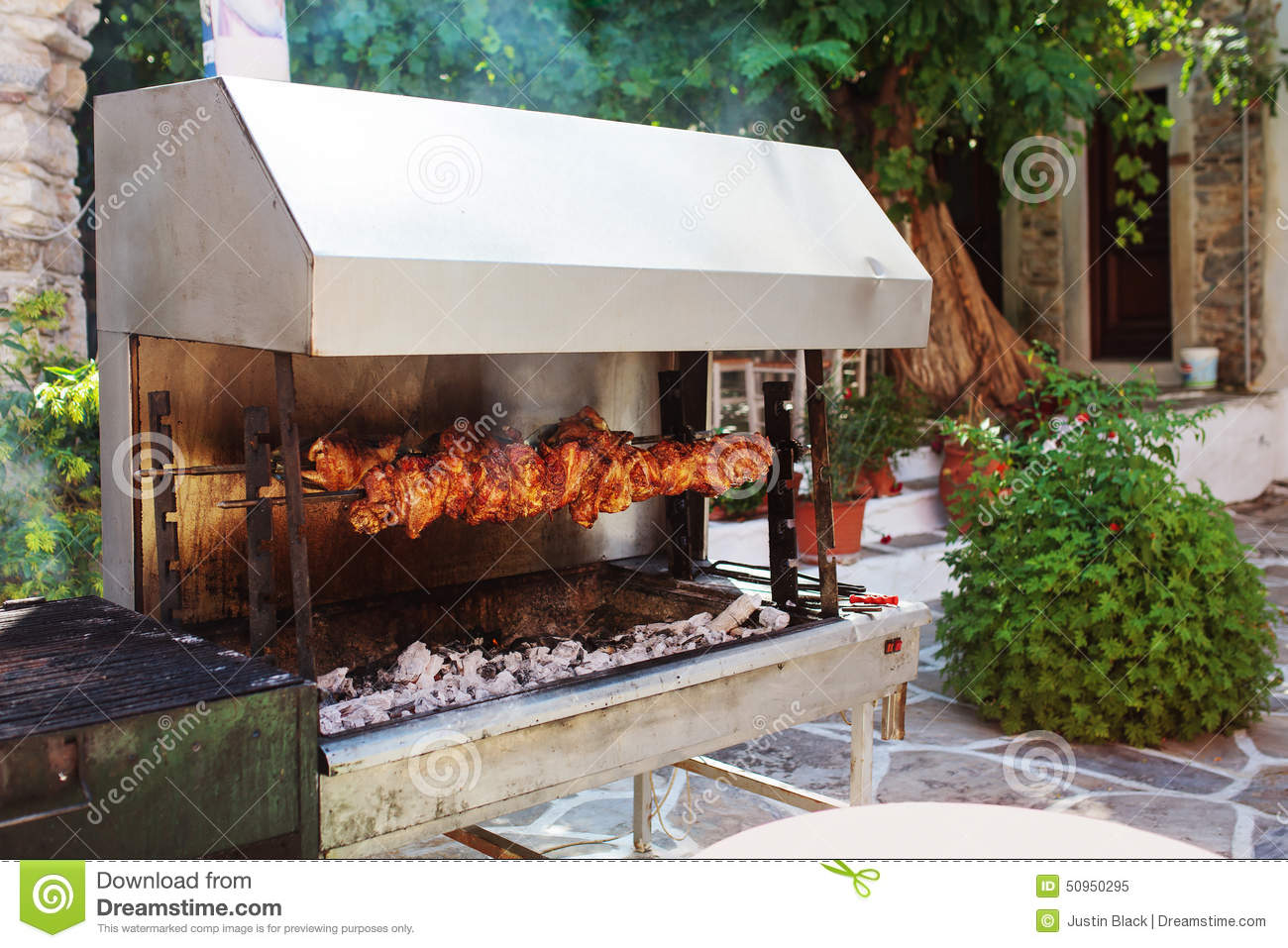 Outdoor Grill With Meat In Naxos Island, Greece.