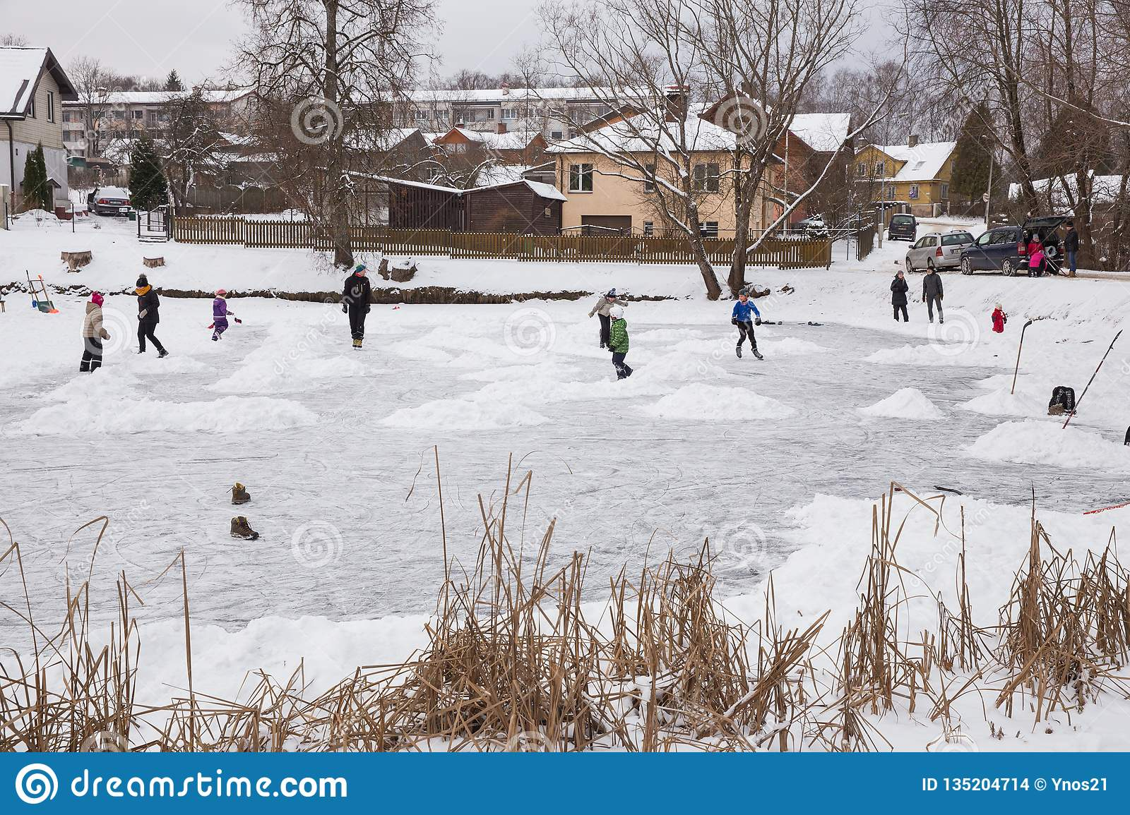 Outdoor ice hokey, players and frozen pond. Travel photo 2018