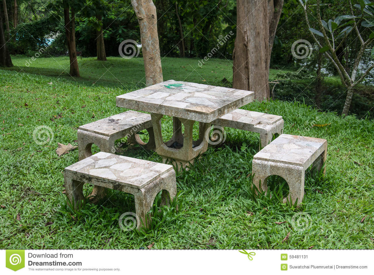 Outdoor marble table and four chairs. - Outdoor Marble Table And Four Chairs. Stock Image - Image Of Marble