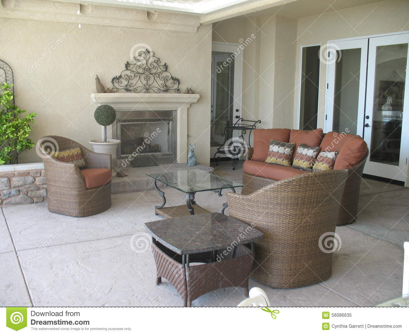 Outdoor Patio With Fireplace And Wicker Furniture