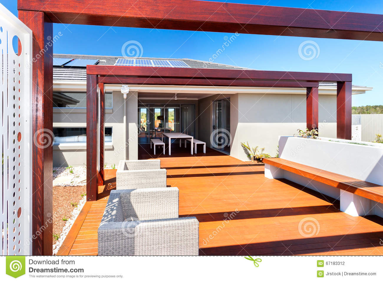 Outdoor patio seating area of a modern house with wooden floor
