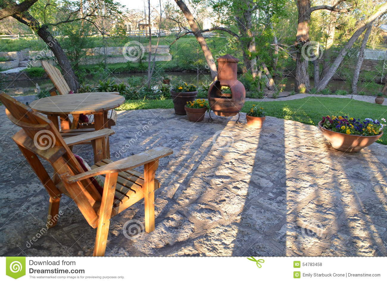 Vacation Home Plans Small Outdoor Patio With Wooden Furniture And Chiminea Stock