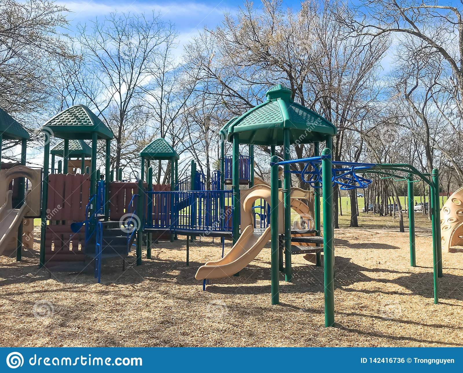 Outdoor playground surrounded by bare trees in wintertime in North Texas, America