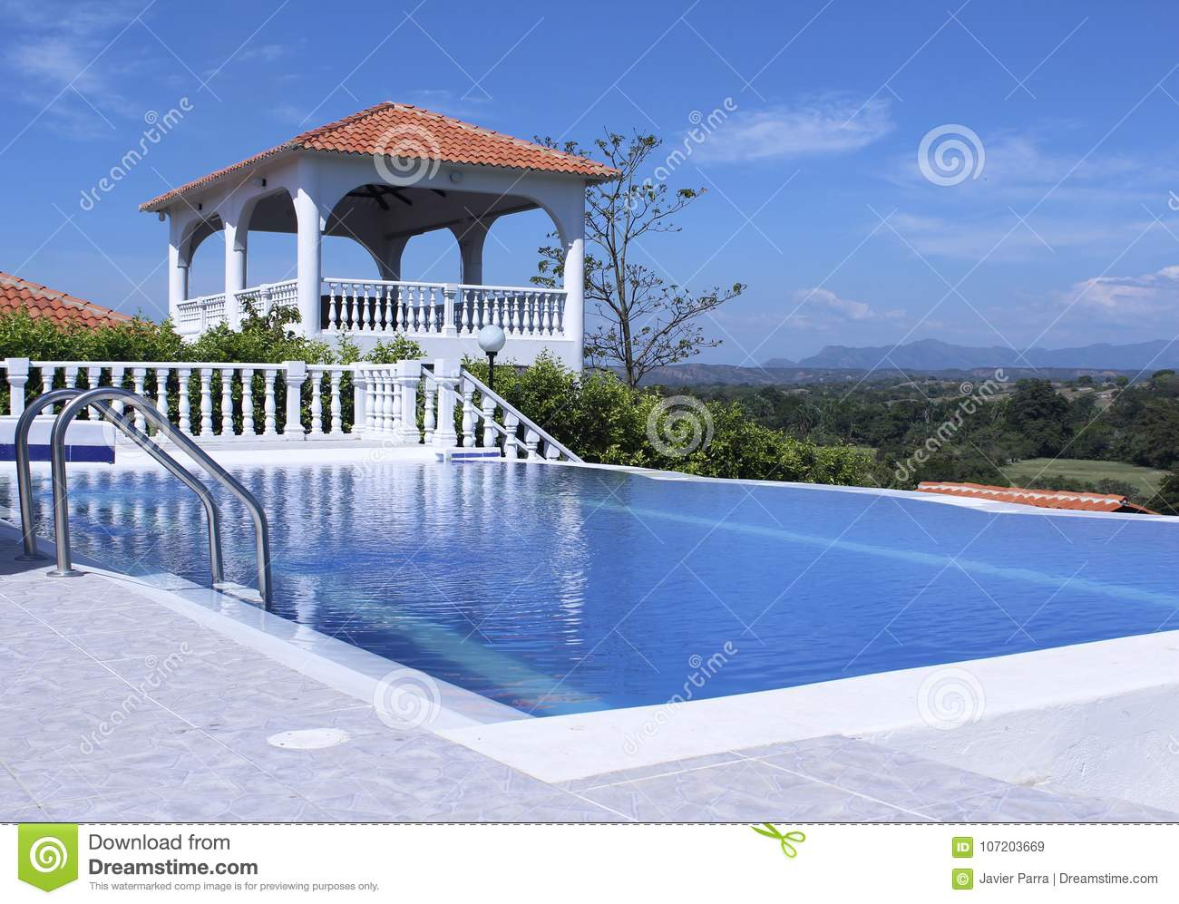Outdoor Pool Area Of Luxury Villa With A Beautiful View
